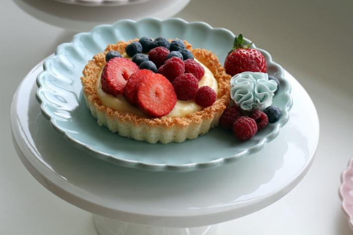 Macaron pastry cases filled with crème pâtissière & fresh fruit